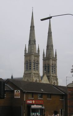 The twin spires of St. Peter's Cathedral, located in the Divis Street area of the Falls Road in Belfast, Northern Ireland, and dates from the 1860s.