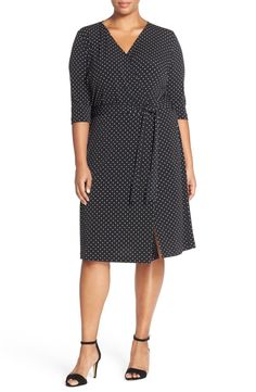 Vince Camuto Dot Print Three-Quarter Sleeve Wrap Dress (Plus Size) at Nordstrom.com. Figure-flattering wrap styling secured with a waist-whittling sash defines a three-quarter-sleeve jersey dress with a charming polka-dot print.
