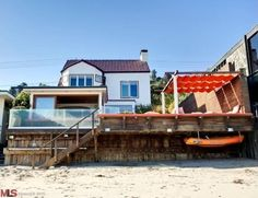 The oldest home on Malibu's private La Costa Beach, #CharlizeTheron's coastal-chic abode is an entertainer's dream with a lounge-like deck and a guest bedroom with a private entrance. Take a peek inside this Oscar-winning actress' home.