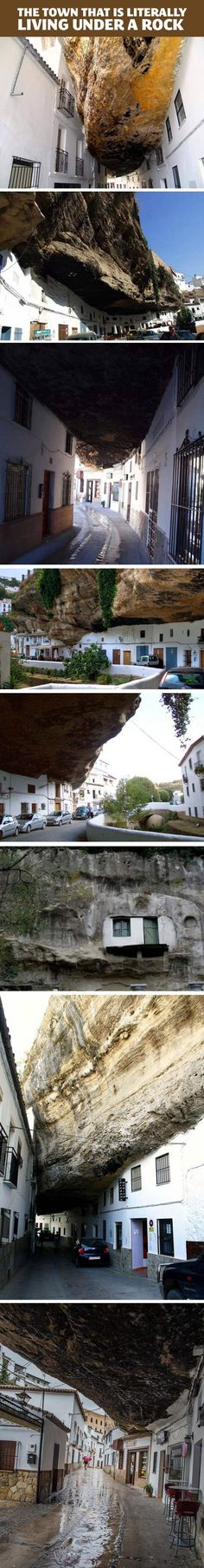 Welcome to the town of Setenil de las Bodegas in Spain where 3,000 of its inhabitants literally live underneath a rock. The town sits along a narrow river gorge weather-beaten by the Rio Trejo River, with many of the houses built into and under the walls of the gorge itself.