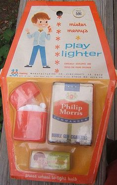 Fun for kids, 1960s style - toy cigarettes & lighter.  Hey... Good idea... Let's teach the kids to smoke!