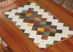 Quilted Table Runner Topper - Scrappy Fall Batiks with Cream. $45.00, via Etsy.