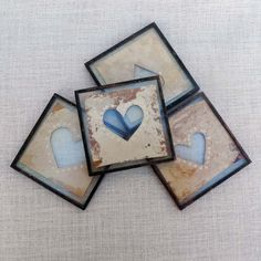 Hand painted recycled tea bag encased in glass.