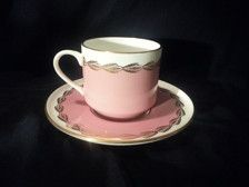 Vintage Aynsley England bone china tea cup and saucer. The colors are white, pink, and gold gilding. Hand painted. Saucer is 5 5/8 diameter.