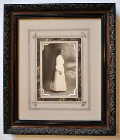 A drug store color photo in a Guerrini inlaid frame.