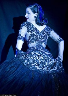 ffded738cea4 Dita Von Teese covers her curves in all red ensemble as she performs  burlesque show