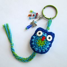 Look what's new! An owl keychain with a butterfly charm! https://www.etsy.com/listing/168541804/crochet-owl-keychain-in-over-the-ocean