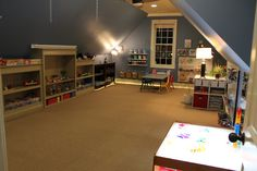 my DREAM play room for the kids.. complete with a light table, more arts and craft supplies than I've ever seen before, and lots of sensory objects. oh, and toys. ah-mazing!!