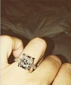 Paulina Gretzky's engagement ring from golfer, Dustin Johnson, is a large princess cut centerstone with a single diamond encrusted band.