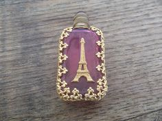 A pink glass perfume bottle with a gilt Eiffel Tower. Perfectly French.