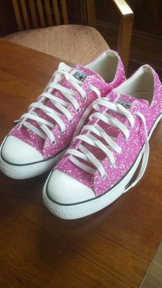DIY Glitter Converse... Need: old Converse, paintbrush, fabric glue, painter's tape, loose glitter, & empty shoebox.  Wash Converse & allow to dry. Set craft area with newspapers & tape off white sections of shoes with painter's tape. Paint fabric glue onto shoes, place into box, & go crazy with glitter!! Shake off & reuse excess glitter. Allow to dry overnight.