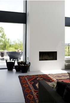 living space l fireplace and windows l photo by Marjon Hoogervorst