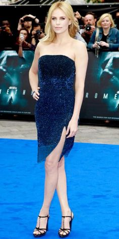 Look of the Day › June 1, 2012 WHAT SHE WORE The actress took the spotlight at the London premiere of Prometheus in a navy Dior Haute Couture tube dress, sapphire and diamond Bulgari jewels and strappy sandals. WHY WE LOVE IT Now who's the fairest of them all? Charlize Theron stepped away from from her evil queen role in an enchanting cocktail dress