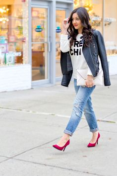 Boyfriend jeans, a graphic sweater, a leather jacket and RED heels