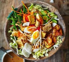 Gado Gado is a typical Indonesian dish made from vegetables and peanut sauce. As a rule, Gado Gado is vegetarian. Bbc Good Food Recipes, Vegetarian Recipes, Cooking Recipes, Healthy Recipes, Healthy Food, Indonesian Cuisine, Indonesian Recipes, Asian Recipes, Ethnic Recipes