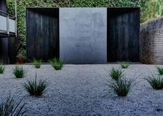 Crescent House. Australian architect Andrew Burns has installed this charred timber pavilion with deceptively curved walls in the garden of the Sherman Contemporary Art Foundation in Paddington, Sydney