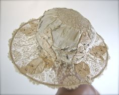 Edwardian silk and lace couture hat | France, 1910-1916 | Materials: silk, lace, metallic threads, tiny seed pearls, rhinestones