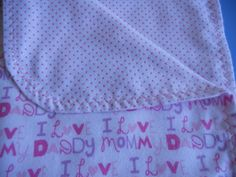 Girls baby blanket with I love mommy and I love daddy on one side and pink dots on the other side.Colors pink and lite purple. by MissyCraftsandGoods on Etsy