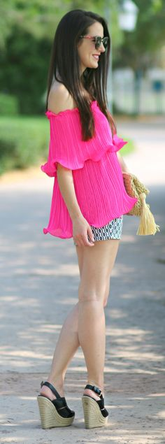 Hot pink Bardot top with black and white geo print shorts, tall black wedges, Ann Taylor straw clutch, BaubleBar drop earrings, black Daniel Wellington watch, and black cat eye sunglasses | How to Wear a Bardot Top: Guide to Off-Shoulder Styling by Stephanie Ziajka from Diary of a Debutante