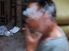 china--guangdong--guangzhou--daytime--qing-ping-market-area--people--man-smoking--2015-04-17--ribba