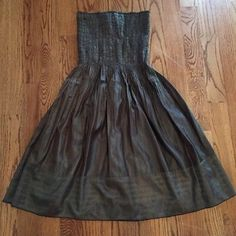 🎉lowest! Really pretty brown strapless dress Final price drop!! Such a pretty brown dress with hints of light blue throughout. It's nice quality,I paid too much at Dillard's. I had s brown ribbon that I tied around the waist just for added style and cuteness (not sure where it is,didn't come w the dress). Very nice. Soft,silky material. Lyndia Dresses Strapless
