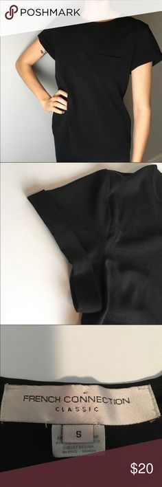 French connection black top French connection black top. Reposh. Too short on my for my liking. EUC. Only worn once by me to try on. Super cute pocket on front and nice material. French Connection Tops Tees - Short Sleeve