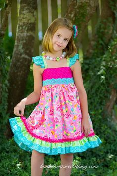 Girls handmade boutique dress in a gorgeous assortment of colorful and bright fabrics. Lovely details include flutter sleeves, elasticized back, double ruffled hem. All items are made with 100% cotton