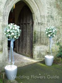 Flower topiary tree, which coordinates with wedding ceremony flowers