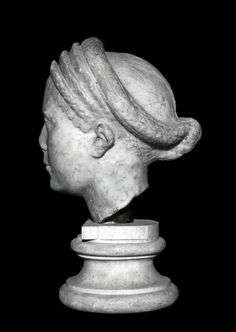 Marble portrait head from a statue of a woman, possibly Marciana Augusta.