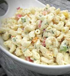Recipe for Party Macaroni Salad - This recipe makes a great side dish for any summer barbecue or picnic. Make it in advance and refrigerate it for at least two hours.