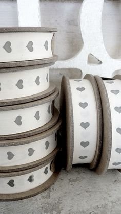 white ribbon with grey heart