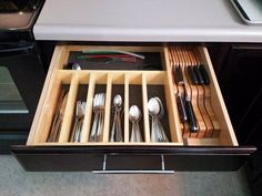 Organized Cutlery Drawer - Like the knife block on the side