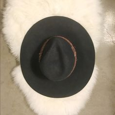 Wide brim %100 wool hat - Anthropologie Navy wide brimmed hat with leather braided trim. %100 wool from Anthro - good condition. The leather on the trim started to come off so I had it repaired. Very boho chic!! Anthropologie Accessories Hats