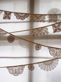 vintage doily bunting - but more of an inspiration for paper snowflakes bunting
