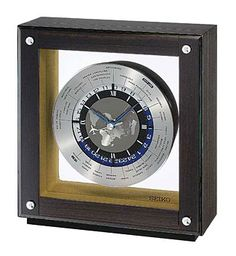 """The Seiko World Time Desk Clock has an automatic world time dial with 25 time zones at a glance. Dark ebony veneer wooden case with a glass crystal. The quiet sweep second hand moves in a continuous motion. One """"aa"""" battery is included. Size: H 9 W D 3 Contemporary Mantel Clocks, Seiko, Denver, Vancouver, World Timer, Timer Clock, Wood Mantels, Mens Skechers, Desk Clock"""