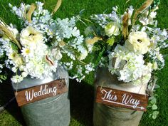 Rustic milk churns, filled with flowers and custom made signage, vintage paper butterflies all from Sweetpea and Ivy wedding prop hire, Rustic Romance - Sweetpea and Ivy