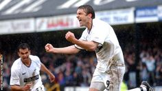 James Thomas celebrates after his hat-trick against Hull keeps Swansea in the Football League