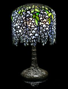 7bb8ba87d15 Bonhams 1793   A Tiffany Studios Favrile glass and patinated-bronze Pony  Wisteria table lamp circa 1910