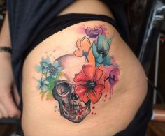 I love the flowers in this bright tattoo by Koray Karagözler.