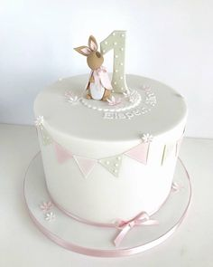 Browse through the different cakes we create here at The Pretty Sugar Cake Company, from Wedding Cakes & Wedding Favours to Celebration Cakes, to Cupcakes & Cookies. 1 Year Old Birthday Cake, 1 Year Old Cake, 1st Year Cake, 1st Birthday Cake For Girls, Baby Birthday Cakes, Birthday Wishes, Fondant Cupcakes, Beatrix Potter Cake, Luxury Cake