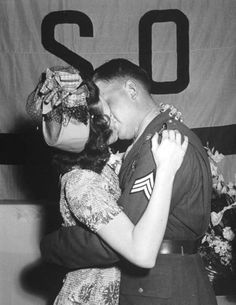 A soldier kissing his bride after their wedding. 1942
