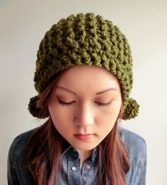 Pom Pom Hat with Ear Pom Poms | Fend off the fiercest of winter gales with this knit hat. It f... | Hats