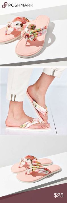 Tropical print thong Give your look a touch of paradise with this printed thong sandal, UO. Tropical printed sandal with thick seamed straps accented with a bow at toes. Laid on a flat, cushy EVA sole.  Content + Care - Cotton, polyester, EVA - Wipe clean Urban Outfitters Shoes