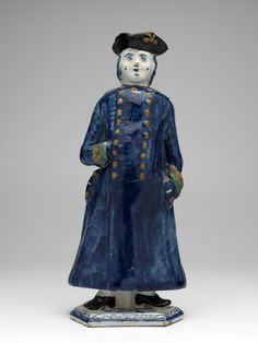 Dutch Delft, polychrome statue of a standing man with long, blue coat on pedestal, height: 25,1 cm., museum Arnhem, The Netherlands