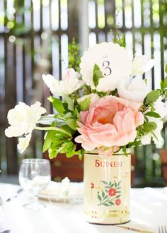 smitten -- love the flowers, antique tin can, scalloped paper!