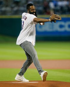 James Harden Photos - James Harden of the Houston Rockets throws out the first pitch before the Houston Astros play the Los Angeles Angels of Anaheim at Minute Maid Park on September 2015 in Houston, Texas. - Los Angeles Angels of Anaheim v Houston Astros Houston Rockets, Houston Astros, Number 13, Dennis Rodman, James Harden, Nba, Basket, Baseball Cards, Fitness