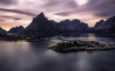 landscape photo sea water fjords stone coast Norway Lofoten islands fog mystic mountains cliffs sunset red houses fishing houses gray pink yellow bridge Nico Rinaldi nicorinaldi