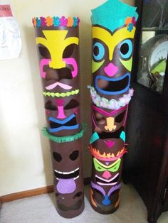 Tikis for brownie luau made from cardboard cement tubes available at home improvement tubes.