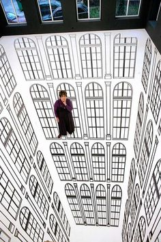 Earlier this year we came across Brazilian artist Regina Silveira's incredible installation Depth which was displayed back in 2010 at Atlas Sztuki Gallery of Contemporary Art in Lodz, Poland. By incorporating the gallery's architecture, particularly its windows, she created a never-ending abyss that one could actually walk on.