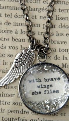 With Brave Wings She Flies Necklace. Very unique piece of jewelry